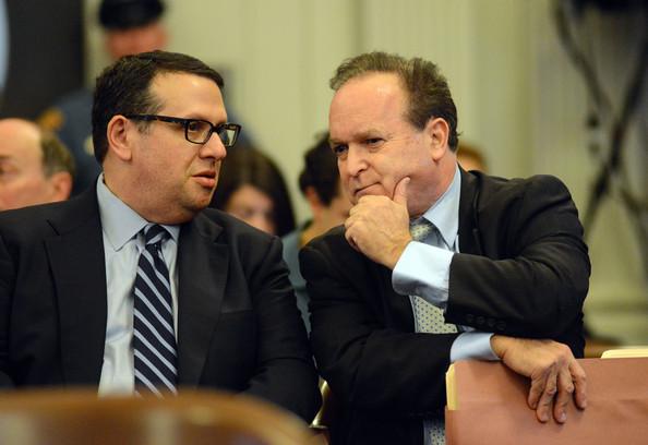 2 men in court both sitting